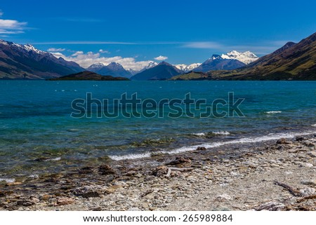 Wakatipu lake view with South Alps on horizon, South island of New Zealand - stock photo