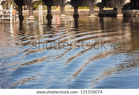 Wake and Reflections on the Hillsborough River, Tampa, Florida - stock photo