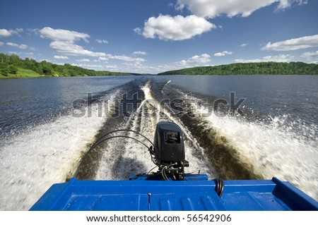 Wake behind motor boat underway and great veiw on river - stock photo