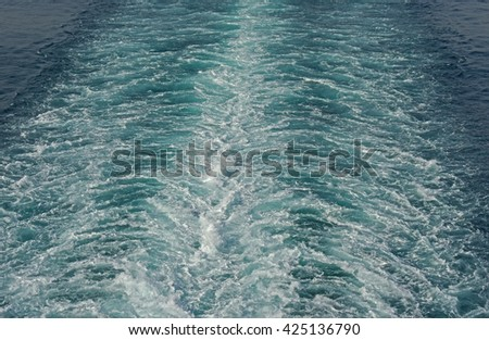Wake caused by a cruise ship - stock photo