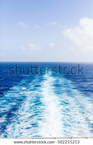 Wake from a Cruise ship into distance on blue sea