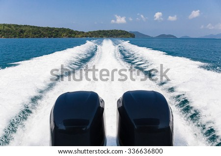 Wake of speed boat in the tropical sea - stock photo