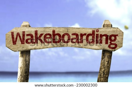 Wakeboarding sign with a beach on background - stock photo
