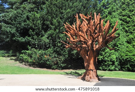 WAKEFIELD, UK - AUGUST 6, 2016. Iron Tree is a sculpture by Al Weiwei, exhibiting at the Yorkshire Sculpture Park, near Wakefield, west Yorkshire, UK.