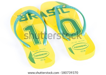 WAKEFIELD, UK - MARCH 4, 2014 - Havaianas World Cup Edition - Brasil. Popular Brazilian flip-flop brand made by Alpargatas. Isolated on a white background. - stock photo