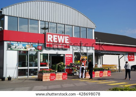 WALDFEUCHT, GERMANY - MAY 11, 2016 : Entry of a REWE supermarket, part of the REWE Group, a German diversified retail and tourism group, operates in 14 European countries. - stock photo