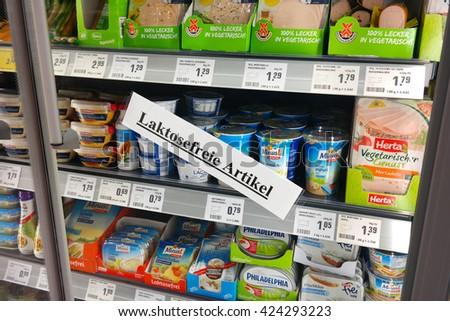 WALDFEUCHT, GERMANY - MAY 11, 2016: Label in German for Lactose free refrigerated fresh products, for Lactose intolerance in a REWE supermarket. Lactose intolerance is the inability to digest lactose.