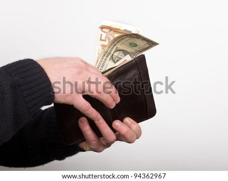 walet with dollars and euros in the hand of a man - stock photo