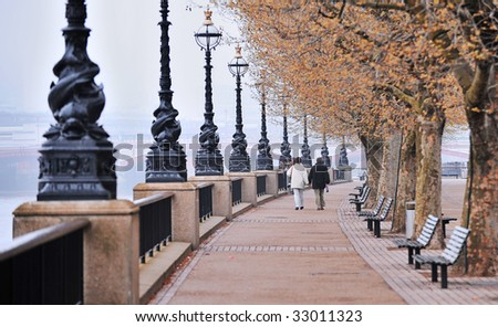 Walk along the Thames in London on a cold morning - stock photo