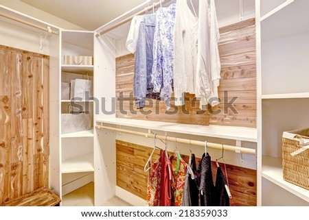 Walk-in closet with solid wood planks and white storage shelves
