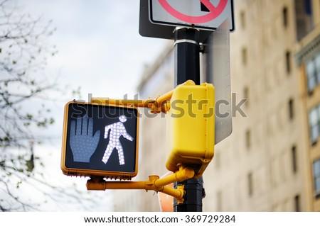 Walk New York traffic sign on blurred background  - stock photo