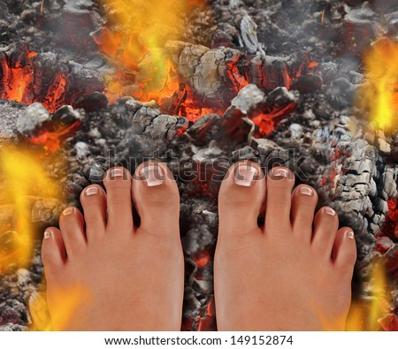 Walk on fire as a life and culture concept of the power of faith and mind over matter as a rite of passage ritual and ancient tradition walking over hot burning coals with fire flames and smoke. - stock photo
