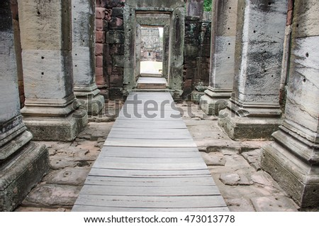 walk way in Arch of Ancient City Historical Park frame mirror image appears  in blue sky