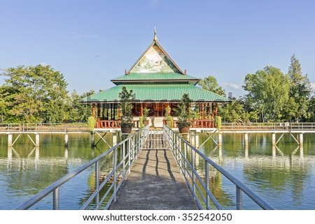 walk Way to the waterfront public pavilion hall and blue sky in public temple thailand