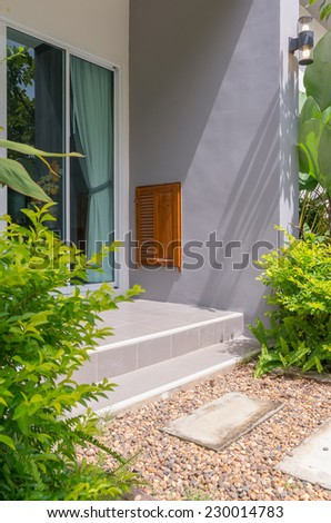walk way with garden In front of house