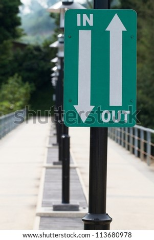 Walk way with in and out sign - stock photo