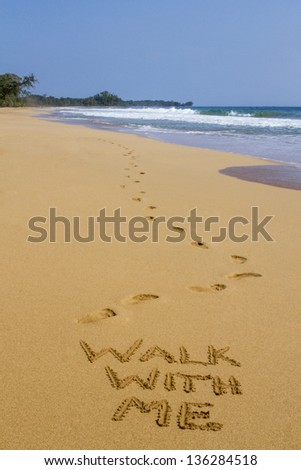 Walk With Me � Footprints and Message in the Sand - stock photo