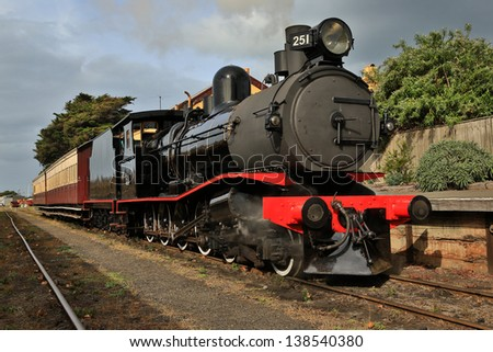 Walkers Ltd narrow gauge steam locomotive T251(c1917) with two carriages at Queenscliff railway station in Victoria, Australia. - stock photo