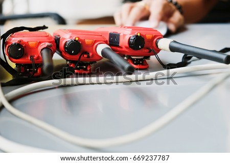 Walkie talkie background, close up image of red Walkie talkie are placed on the table background.