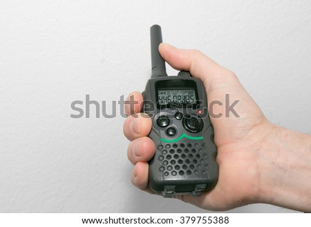 Walkie-Talkie holding in the Hand - stock photo