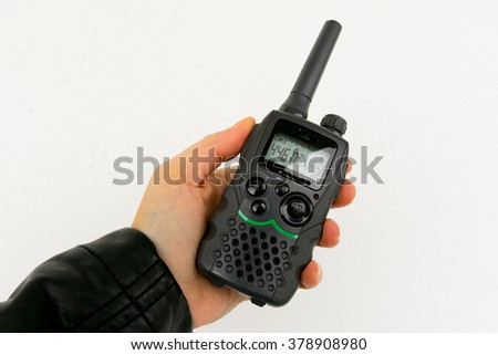 Walkie Talkie in a Hand in front of a white backgrounde - stock photo