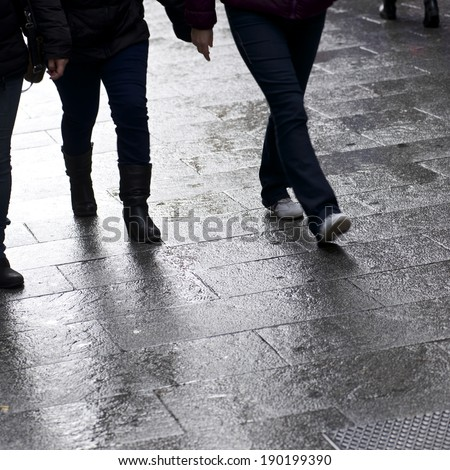 Walking along a cobblestone street, Old City Madrid, Spain