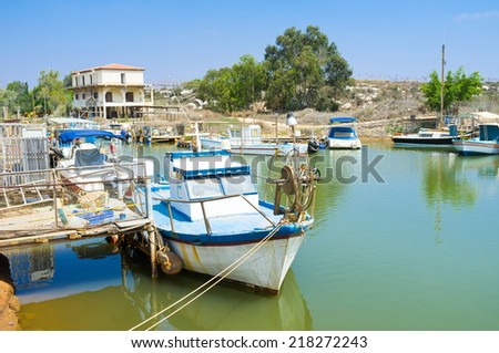 Walking along the river it's easy to find many old boats, moored next to the banks, Liopetri, Cyprus.
