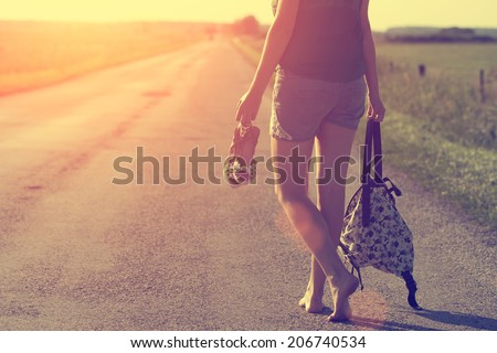 Walking away in summer sunset - stock photo