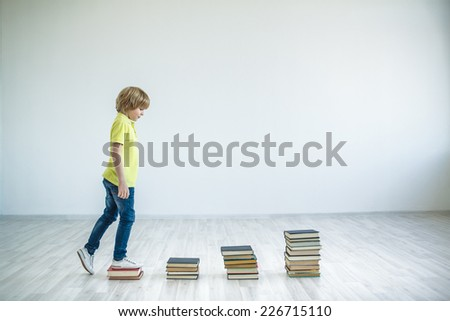 Walking boy with books - stock photo