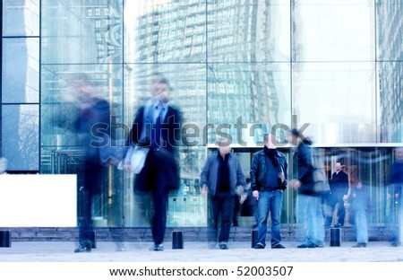 walking business people rushing on the street in intentional motion blur