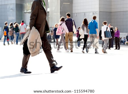 Walking businessman. A group of young people and businessmen walking on the background of the urban landscape. Urban landscape. - stock photo