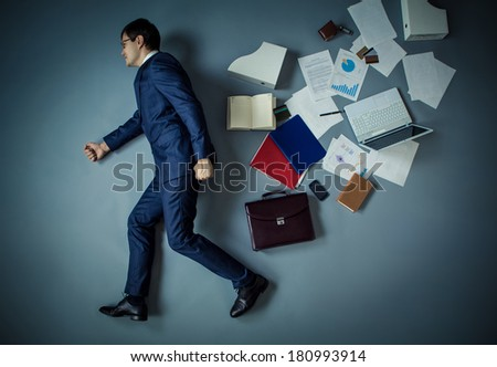 Walking businessman in a suit in studio - stock photo