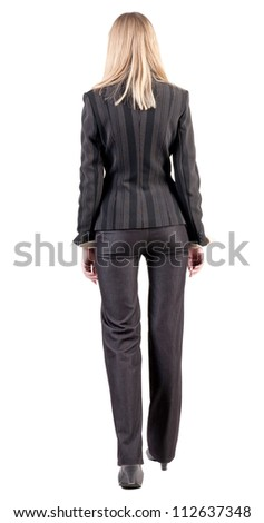 walking businesswoman. back view. going young girl in  suit. Rear view people collection.  back side view of person.  Isolated over white background. - stock photo