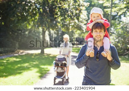 walking family - stock photo