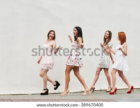 walking four young women - stock photo