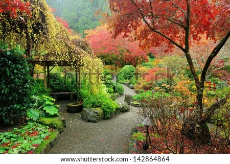 walking in Japanese Garden of the national historical site Butchart Gardens, Vancouver island, British Columbia, Canada - stock photo