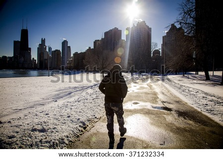 walking in snow. Blizzard - stock photo