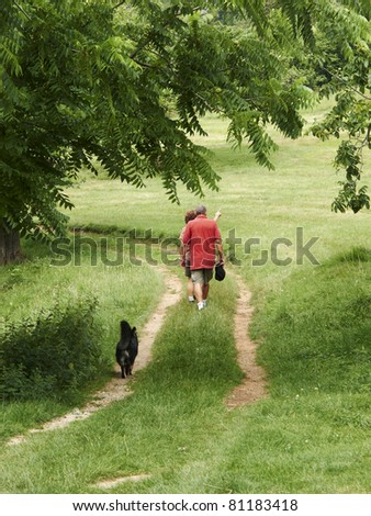 walking in the country with dog - stock photo