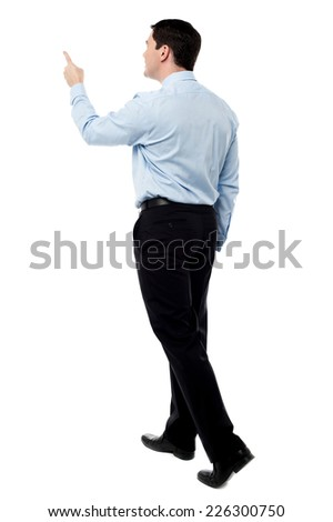 Walking man pointing with finger, isolated over a white  - stock photo