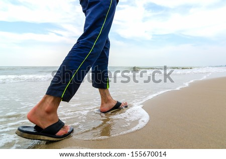 Walking near the beach. Close-Up on Legs with selected focus. Shallow DOF - stock photo