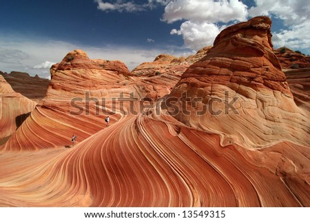 Walking on a perfect rock formation in Vermillion Cliffs Wilderness. Famous rock formation in Pariah Canyon. Utah. America