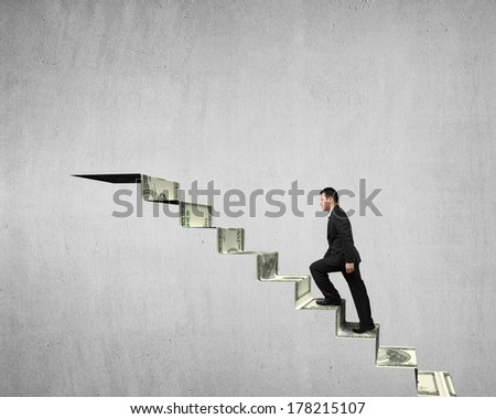 Walking on money stairs to top concrete wall background