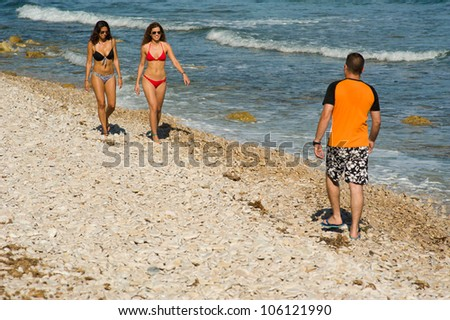Walking on the beach and enjoying a sexy landscape - stock photo