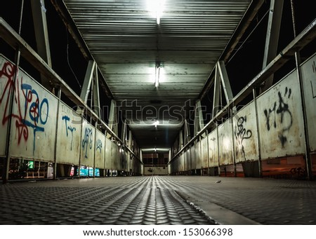 Walking on the overpass at night. - stock photo