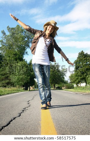Walking on the yellow line in a middle of the road