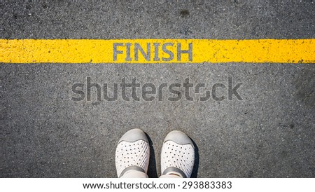 walking on yellow street lines concept of business success.