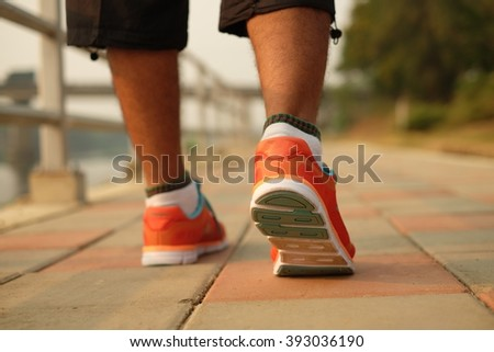 Walking or running legs sport shoes, fitness and exercising in autumn or winter nature. Jogging or training outside in fall nature, motivational health and fitness concept.