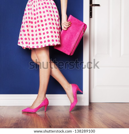 Walking out concept, girl dressed in pink - stock photo