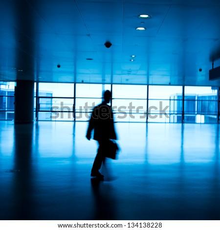 Walking passenger at the airport, motion blur. - stock photo