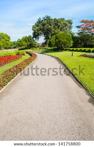 Walking path in the garden of Suan Luang Rama 9 park, Bangkok, Thailand - stock photo